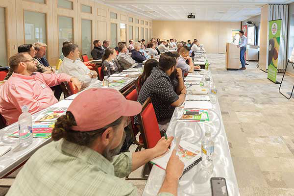 speaker giving a lecture to a group at one of the many thought leadership conferences by the Culinary Institute of America.