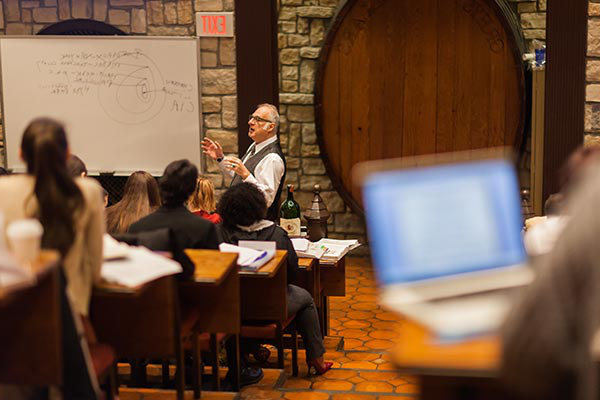Students attending a class for the 澳门人威尼斯app手机官网's Wine Management Master's Degree.